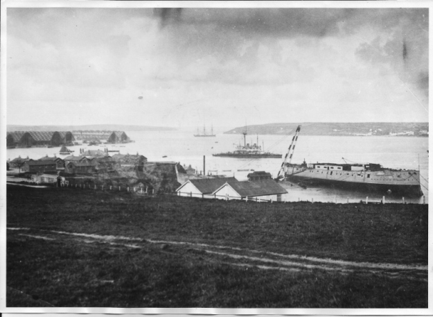 Pembroke Dock in c.1896. No. 1 slip, where Renown was launched, is the furthest of the covered slipways. HMS Hannibal, referred to in the article, lies at Hobbs Point; port guardship HMS Thunderer at anchor beyond her. (Tenby Museum)